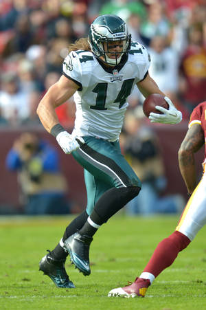 Photo - LANDOVER, MD - NOVEMBER 18:  Riley Cooper #14 of the Philadelphia Eagles runs with the ball during the game against the Washington Redskins at FedEx Field on November 18, 2012 in Landover, Maryland. The Redskins won 31-6. (Photo by Drew Hallowell/Philadelphia Eagles/Getty Images)