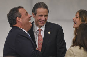 Photo - New Jersey Governor Chris Christie, left, and New York Gov. Andrew M. Cuomo talk at the dedication of the National September 11 Memorial Museum  in New York, May 15, 2014.  (AP Photo/Timothy A. Clary, Pool.)