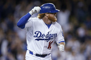 Photo - Los Angeles Dodgers' Justin Turner runs up the first base line after hitting an RBI single to score Juan Uribe against the St. Louis Cardinals during the eighth inning of a baseball game, Thursday, June 26, 2014, in Los Angeles. (AP Photo/Danny Moloshok)