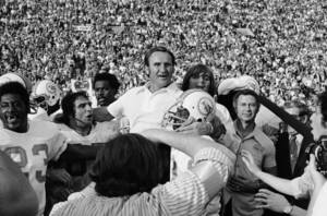 Photo - FILE - In this Jan. 14, 1973 file photo,  Miami Dolphins coach Don Shula is carried off the field after his team won NFL football Super Bowl game with a 14-7 victory over Washington Redskins in Los Angeles. Shula is having the 1972 Dolphins over to his house for dinner Thursday night to help celebrate the 40th anniversary of their perfect season. (AP Photo/File)