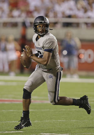 Photo - Utah State quarterback Chuckie Keeton (16) scambles in the second half during an NCAA football game against Utah Thursday, Aug. 29, 2013, in Salt Lake City. Utah defeated Utah State 30-26. (AP Photo/Rick Bowmer)