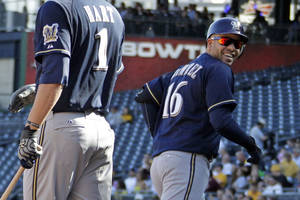photo -   Milwaukee Brewers' Aramis Ramirez, right, celebrates with teammate Corey Hart (1) after hitting a two-run home run off Pittsburgh Pirates starting pitcher Wandy Rodriguez during a baseball game in Pittsburgh, Thursday, Sept. 20, 2012. (AP Photo/Gene J. Puskar)