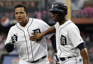 Photo -   Detroit Tigers' Miguel Cabrera, left, celebrates hitting a two-run home run with Austin Jackson against Cleveland Indians starting pitcher Ubaldo Jimenezin the first inning of a baseball game in Detroit, Wednesday, Sept. 5, 2012. (AP Photo/Paul Sancya)