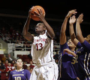 Photo - Stanford forward Chiney Ogwumike (13) goes up for a layup during the second half of an NCAA college basketball game against Washington on Thursday, Feb. 27, 2014, in Stanford, Calif. Stanford won 83-60. (AP Photo/Marcio Jose Sanchez)