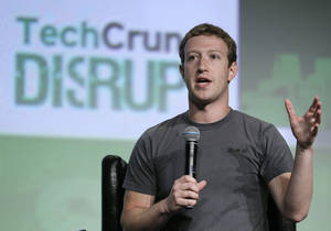 "photo -   Facebook CEO Mark Zuckerberg speaks during a ""fireside chat"" at a conference organized by technology blog TechCrunch in San Francisco, Tuesday, Sept. 11, 2012. Zuckerberg gave his first interview since the company's rocky initial public offering in May. (AP Photo/Eric Risberg)"