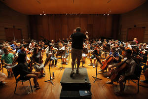 Photo - Director Jeffrey Grogan leads the orchestra in a rehearsal at Quartz Mountain Oklahoma Summer Arts Institute in Lone Wolf, Thursday, June 14, 2012.  Photo by Garett Fisbeck, The Oklahoman