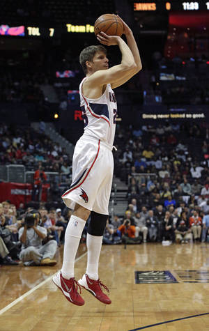 Photo - Atlanta Hawks shooting guard Kyle Korver (26) hits a three-point basket to tie the NBA record for consecutive games with a three pointer in the first half of an NBA  basketball game against the Los Angeles Clippers Wednesday, Dec. 4, 2013, in Atlanta.  (AP Photo/John Bazemore)