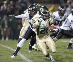 Photo -   Cal Poly's Chris Nicholls (22) looks for an opening against Portland State's Dionte Brooks (1) during the second quarter of an NCAA college football game Saturday, Oct. 20, 2012, in San Luis Obispo, Calif. (AP Photo/The Tribune, Laura Dickinson)