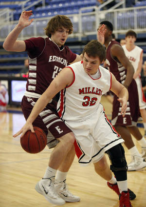 Photo - Yukon's Noah Gillett works around Edmond Memorial's Joey Martinelli during the Yukon vs. Edmond Memorial boys game of the Deer Creek, Bruce Gray Invitational basketball game at Deer Creek High School in Oklahoma City, OK, Thursday, January 23, 2014,  Photo by Paul Hellstern, The Oklahoman