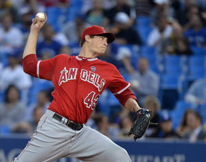 Photo - Los Angeles Angels starting pitcher Garrett Richards throws against the Toronto Blue Jays during first inning of a baseball game action on Thursday, Sept. 12, 2013, in Toronto (AP Photo/The Canadian Press, Nathan Denette)