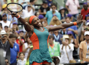 Photo - Serena Williams celebrates after defeating Li Na, of China, 7-5, 6-1 in the women's final at the Sony Open Tennis tournament, Saturday, March 29, 2014, in Key Biscayne, Fla. (AP Photo/Alan Diaz)