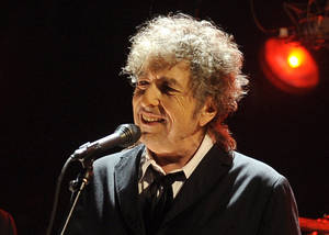 Photo -   FILE - In this Jan. 12, 2012 file photo, Bob Dylan performs in Los Angeles. Fifty years into his career as a recording artist and a week away from release of an extraordinary new CD, Dylan spent his Tuesday evening where he seems to feel most comfortable — on a stage. (AP Photo/Chris Pizzello, File)