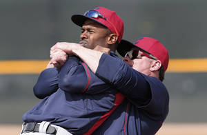 Photo - Cleveland Indians' Jason Giambi, right, cracks Michael Bourn's back during spring training baseball practice in Goodyear, Ariz., Friday, Feb. 21, 2014. (AP Photo/Paul Sancya)