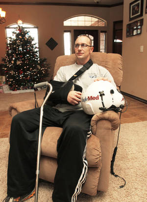 Photo - Michael Eccard in his Edmond home Dec. 16, 2010, five months after he survived a fatal helicopter crash. Photo by Jim Beckel, The Oklahoman <strong>JIM BECKEL - THE OKLAHOMAN</strong>