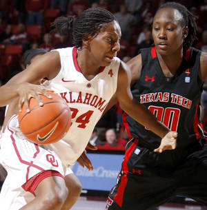 photo - Oklahomas Sharane Campbell goes around Texas Techs Chynna Brown earlier this season. Photo by Bryan Terry, The Oklahoman