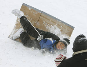 Photo - Ten year old Karon Willis tumbles from his sled at Will Rogers Park in Oklahoma City, OK, Saturday, Jan. 30, 2010. By Paul Hellstern, The Oklahoman
