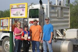 Photo - Sonic franchisees Julie Dorries (far left) and Tommy Dorries (far right), along with carhop Halee Elledge (second from left), greet a local guest as he pulls into the first Sonic Drive-In stall built for truck drivers. <strong> - PROVIDED BY SONIC</strong>