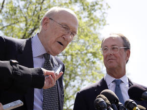 Photo -   FILE - This April 14, 2011 file photo shows Erskine Bowles, right, Alan Simpson, co-chairmen of the president's deficit reduction commission, talking to reporters outside the White House in Washington after their meeting with President Barack Obama. The election may be over, but a new campaign is being waged in the nation's capital as lobbyists, advocates and trade groups fight to shape the government's response to the looming fiscal cliff. It's a twist on the usual lobbying effort: Instead of digging for more tax dollars, they're trying to protect what they've got. (AP Photo/Carolyn Kaster, File)