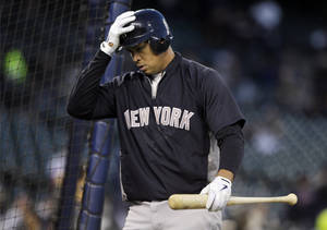 Photo -   New York Yankees' Alex Rodriguez walks out of the batting cage following batting practice before the start of Game 3 of the American League championship series against the Detroit Tigers Tuesday, Oct. 16, 2012, in Detroit. (AP Photo/Matt Slocum)
