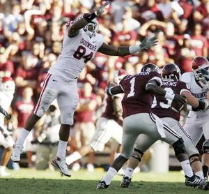 Photo - OU's  Frank  Alexander leaps toward Texas A&M's Jerrod Johnson during the college football game between the University of Oklahoma and Texas A&M University at Kyle Field in College Station, Texas, Saturday, November 8, 2008. BY BRYAN TERRY, THE OKLAHOMAN
