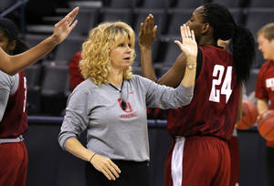 Photo - Oklahoma head coach Sherri Coale high fives players at practice during the press conference and practice day at the Oklahoma City Regional for the NCAA women's college basketball tournament at Chesapeake Arena in Oklahoma City, Saturday, March 30, 2013. Photo by Sarah Phipps, The Oklahoman