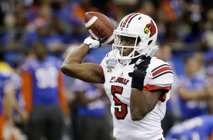 Photo - FILE - In this Jan. 2, 2013, file photo, Louisville quarterback Teddy Bridgewater throws before the Sugar Bowl NCAA college football game against Florida in New Orleans. Bridgewater's ability to remain efficient could determine where he is in December and whether Louisville's season will end in January. (AP Photo/Bill Haber, File)