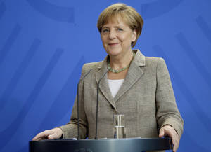 Photo - German Chancellor Angela Merkel smiles during a joint news conference with the Prime Minster of Moldova Iurie Leanca as part of a meeting at the chancellery in Berlin, Germany, Thursday, July 10, 2014. (AP Photo/Michael Sohn)