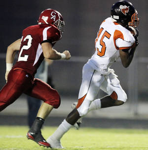 Photo - Booker T. Washington's Dante Barnett (15) makes a touchdown catch in front of Carl Albert's Taylor Hawkins (12) last season. Photo By Nate Billings, The Oklahoman