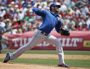 Photo - Toronto Blue Jays starting pitcher Esmil Rogers delivers in the second inning of a spring exhibition baseball game against the Philadelphia Phillies in Clearwater, Fla., Thursday, March 20, 2014. The Blue Jays won 3-1. (AP Photo/Kathy Willens)