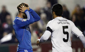 Photo - Real Madrid's Sergio Ramos fails to score against Olimpic Xativa during their Copa del Rey soccer match at the La Murta stadium in Xativa, Spain, Saturday, Dec. 7, 2013. (AP Photo/Alberto Saiz)