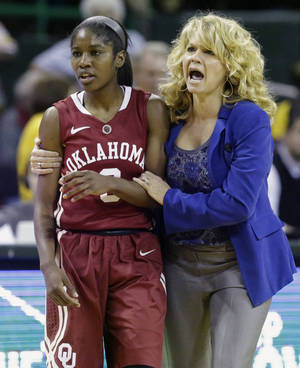Photo - OU coach Sherri Coale consoles hguard Aaryn Ellenberg after Ellenberg was hit during the second half of Monday night's matchup against Baylor. AP photo