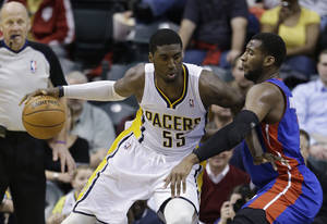 photo - Indiana Pacers' Roy Hibbert (55) works against the defense of Detroit Pistons' Andre Drummond during the first half of an NBA basketball game Wednesday, Jan. 30, 2013, in Indianapolis. (AP Photo/Darron Cummings)