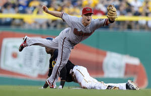 Photo - Arizona Diamondbacks second baseman Aaron Hill, top, reaches for the throw as Pittsburgh Pirates' Starling Marte steals second base in the first inning of a baseball game on Friday, Aug. 16, 2013, in Pittsburgh. (AP Photo/Keith Srakocic)