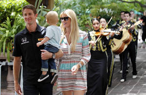 Photo - Indianapolis 500 winner Ryan Hunter-Reay hold his son Ryden, as he and his wife Beccy Gordon Hunter-Reay walk to a speaking engagement at Joe T Garcia's in Fort Worth, Texas, Wednesday, May 28, 2014. The were followed by Mariachi Real de Alvarez. He was in town to promote the Firestone 600 at TMS on June 7. (AP Photo/The Dallas Morning News, Michael Ainsworth)  MANDATORY CREDIT; MAGS OUT; TV OUT; INTERNET USE BY AP MEMBERS ONLY; NO SALES