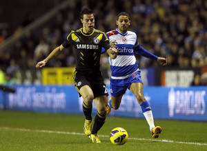 Photo - Reading's Jobi McAnuff, right, watches as Chelsea's Cesar Azpilicueta defends the ball during their English Premier League soccer match at Reading's Madejeski stadium in Reading, England, Wednesday, Jan. 30, 2013. (AP Photo/Kirsty Wigglesworth)