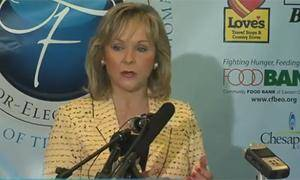 Photo - Oklahoma Gov.-elect Mary Fallin talks about the food drive today. Image from NewsOK.com video