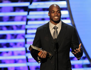 photo - Adrian Peterson of the Minnesota Vikings accepts the NFL.com Fantasy Player of the Year award at the 2nd Annual NFL Honors on Saturday, Feb. 2, 2013 in New Orleans. (Photo by AJ Mast/Invision/AP)