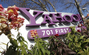 Photo - FILE - In this Jan. 4, 2012 file photo, the company logo is displayed at Yahoo headquarters in Sunnyvale, Calif. One of Britain's youngest Internet entrepreneurs has hit the jackpot after selling his top-selling mobile application Summly to search giant Yahoo the company announced Monday March 25, 2012.  (AP Photo/Paul Sakuma, File) ORG XMIT: NY119 <strong>Paul Sakuma - AP</strong>