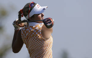 Photo -   Lexi Thompson watches her drive from the 18th tee during second round play in the Navistar LPGA Classic golf tournament, Friday, Sept. 21, 2012, at the Robert Trent Jones Golf Trail in Prattville, Ala. (AP Photo/Dave Martin)