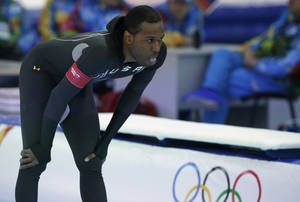 Photo - Shani Davis of the U.S. gestures in dejection after competing in the men's 1,000-meter speedskating race at the Adler Arena Skating Center during the 2014 Winter Olympics in Sochi, Russia, Wednesday, Feb. 12, 2014. (AP Photo/Matt Dunham)