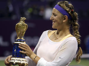 photo - Belarus' Victoria Azarenka displays the trophy, after her victory against Serena Williams of the US, in the final match of the Qatar WTA Ladies Open tennis tournament, in Doha, Qatar, Sunday, Feb. 17, 2013. (AP Photo/Osama Faisal)