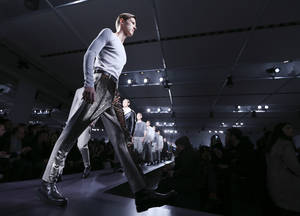 Photo - Models wear creations for Jil Sander men's Fall-Winter 2014 collection, part of the Milan Fashion Week, unveiled in Milan, Italy, Saturday, Jan.11, 2014. (AP Photo/Luca Bruno)