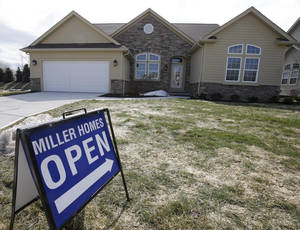 Photo - This Friday, March 21, 2014 photo shows a new home for sale in Pepper Pike, Ohio. Freddie Mac, the mortgage company, releases weekly mortgage rates on Thursday, March 27, 2014. (AP Photo/Tony Dejak)