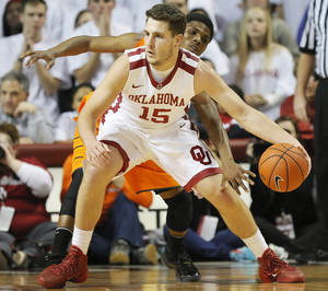 Photo - Oklahoma State's Stevie Clark (5) tries to steal the ball from Oklahoma's Tyler Neal (15) in the first half during the NCAA men's Bedlam basketball game between the Oklahoma State Cowboys (OSU) and the Oklahoma Sooners (OU) at Lloyd Noble Center in Norman, Okla., Monday, Jan. 27, 2014. Photo by Nate Billings, The Oklahoman