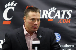 Photo - Cincinnati head coach Butch Jones speaks about their upcoming appearance in the Belk Bowl NCAA college football game against Duke during a news conference, Tuesday, Dec. 4, 2012, in Cincinnati. Jones was weighing his options after returning to the school's campus after two days of interviews at Purdue and Colorado but declined to comment about his interviews or his future. Cincinnati is scheduled to play Duke on Thursday, Dec. 27. (AP Photo/The Cincinnati Enquirer, Joseph Fuqua II)  MANDATORY CREDIT;  NO SALES