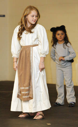 "Photo - Fourth-grader Asher Bartlett,  9,  performs as Cinderella in the play ""Cinderella"" at John Glenn Elementary School. Photo by Paul B. Southerland, The Oklahoman <strong>PAUL B. SOUTHERLAND - PAUL B. SOUTHERLAND</strong>"