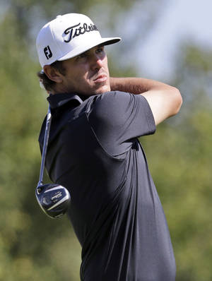 Photo - Brooks Koepka watches his shot from the fourth tee during the second round of the Frys.com Open golf tournament, Friday, Oct. 11, 2013, in San Martin, Calif. (AP Photo/Marcio Jose Sanchez)
