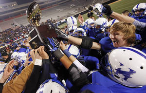 photo - CELEBRATE / CELEBRATION: The Hennessey Eagles raise the gold ball trophy after the Class 2A high school football state championship game between Jones and Hennessey at Boone Pickens Stadium in Stillwater, Okla., Saturday, Dec. 10, 2011. Hennessey won, 21-7. Photo by Nate Billings, The Oklahoman