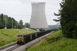 Photo - This photo taken June 2, 2014, shows a coal train stops near White Bluff power plant near Redfield, Ark. President Barack Obama's new pollution limits for power plants have set off an avalanche of information about what the rules will cost, how they'll affect your health, and how far they'll go toward curbing climate change. There's just one problem: Almost none of it is based in reality. That's because Obama's proposed rules, which aim to cut carbon dioxide emissions from power plants 30 percent by 2030, rely on states developing their own, customized plans to meet their targets. Among the options: switching to cleaner fuel sources, boosting efficiency to reduce demand for electricity and trading pollution permits through cap-and-trade. (AP Photo/Danny Johnston)