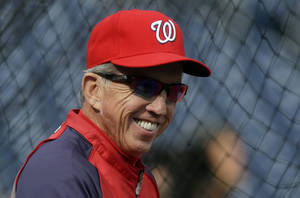 photo -   FILE - In this Oct. 10, 2012, file photo, Washington Nationals manager Davey Johnson watches his players take batting practice before Game 3 of the National League division baseball series against the St. Louis Cardinals in Washington. The Nationals are bringing back Johnson for one more season as their manager. Johnson then will move into a role as a consultant to the club in 2014. The Nationals announced the arrangement Saturday, Nov. 10, 2012. (AP Photo/Pablo Martinez Monsivais, File))